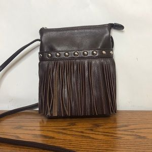 Woman's fringed leather cross body bag